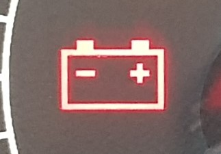 Warning light that looks like a battery.