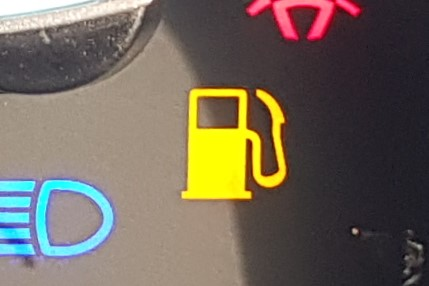 Warning light that looks like a fuel pump.